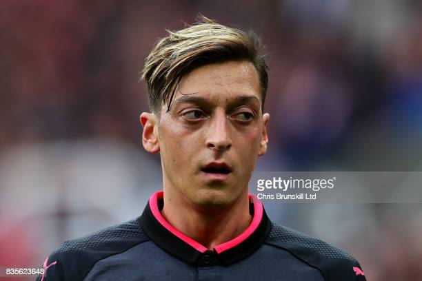 Mesut Ozil of Arsenal looks on during the Premier League match between Stoke City and Arsenal at Bet365 Stadium on August 19 2017 in Stoke on Trent...
