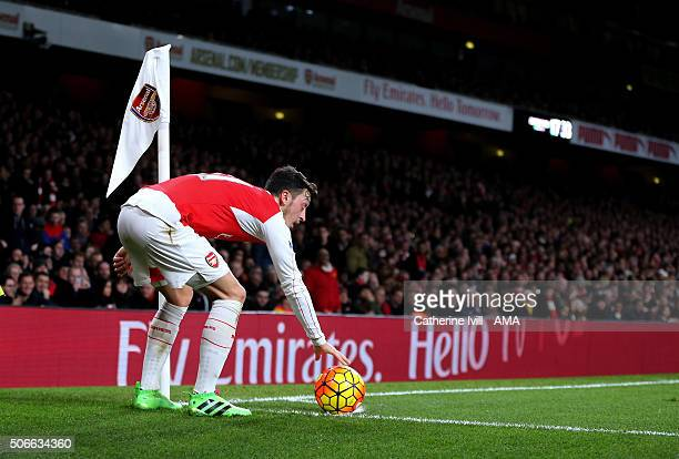 Mesut Ozil of Arsenal prepares to take a corner during the Barclays Premier League match between Arsenal and Chelsea at the Emirates Stadium on...