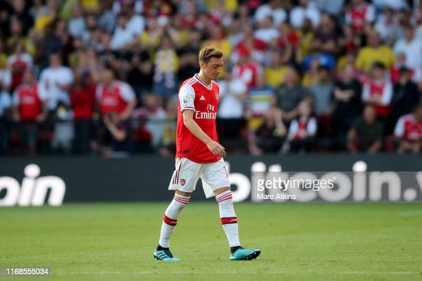 Mesut Ozil of Arsenal reacts as he is substituted during the Premier League match between Watford FC and Arsenal FC at Vicarage Road on September 14...
