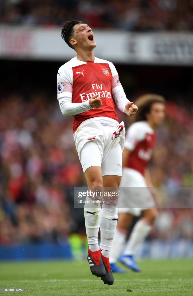 Mesut Ozil of Arsenal reacts during the Premier League match between Arsenal FC and Manchester City at Emirates Stadium on August 12, 2018 in London, United Kingdom.