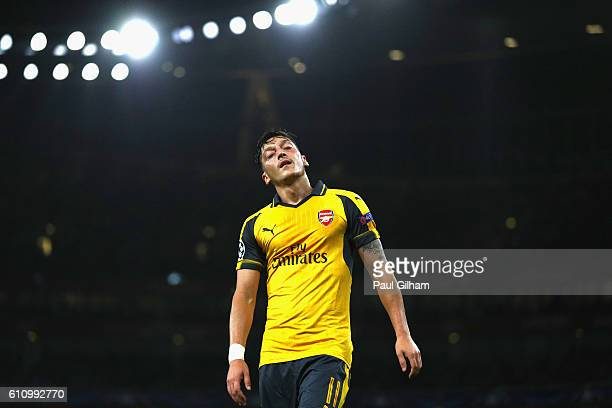 Mesut Ozil of Arsenal reacts during the UEFA Champions League group A match between Arsenal FC and FC Basel 1893 at the Emirates Stadium on September...