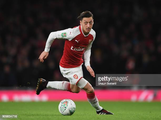 Mesut Ozil of Arsenal runs with the ball during Carabao Cup SemiFinal Second Leg match between Arsenal and Chelsea the at Emirates Stadium on January...