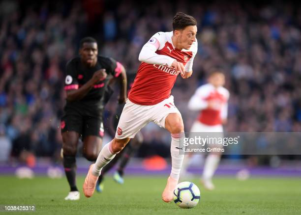 Mesut Ozil of Arsenal runs with the ball during the Premier League match between Arsenal FC and Everton FC at Emirates Stadium on September 23 2018...