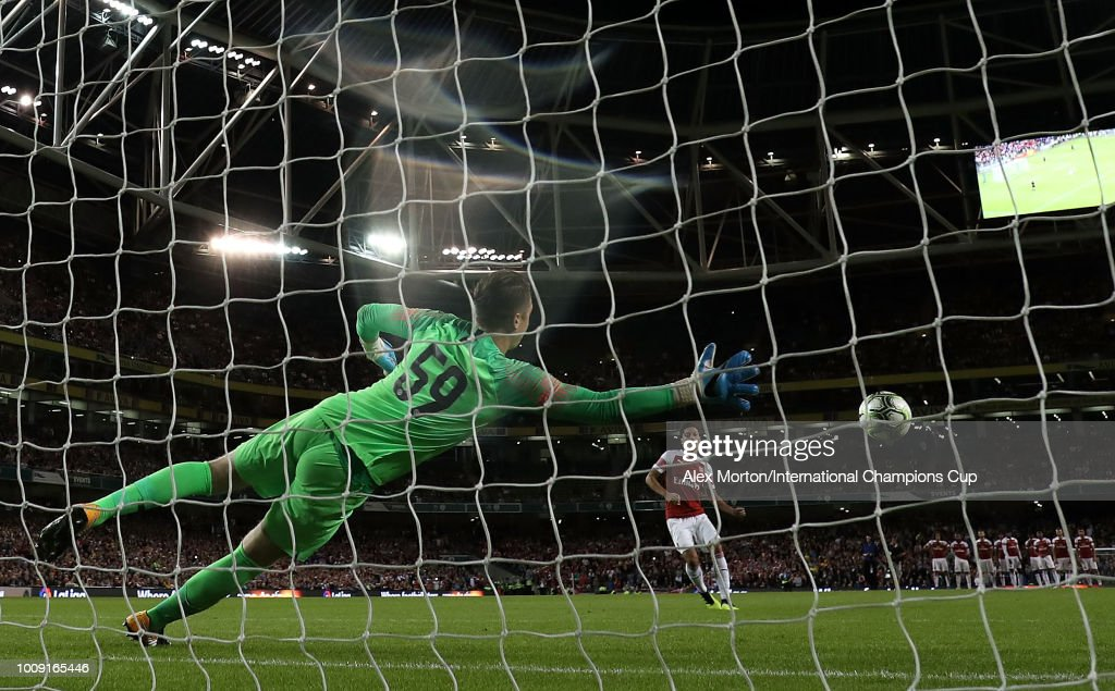 Mesut Ozil of Arsenal scores from the penalty spot during the penalty shoot out during the International Champions Cup 2018 match between Arsenal and Chelsea at the Aviva Stadium on August 1, 2018 in Dublin, Ireland.