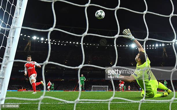 Mesut Ozil of Arsenal scores his second goal of the game during the UEFA Champions League group A match between Arsenal FC and PFC Ludogorets Razgrad...