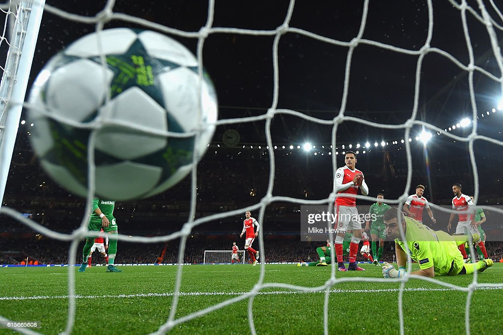 Mesut Ozil of Arsenal scores his second goal of the game during the UEFA Champions League group A match between Arsenal FC and PFC Ludogorets Razgrad at the Emirates Stadium on October 19, 2016 in London, England.