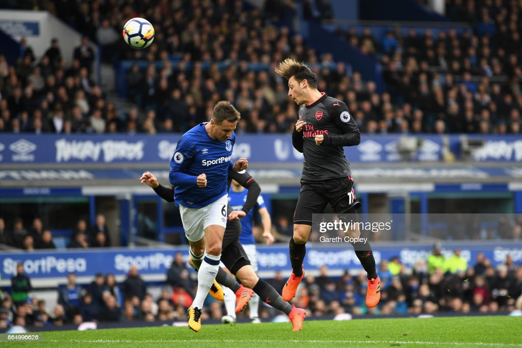 Mesut Ozil of Arsenal scores his sides second goal during the Premier League match between Everton and Arsenal at Goodison Park on October 22, 2017 in Liverpool, England.