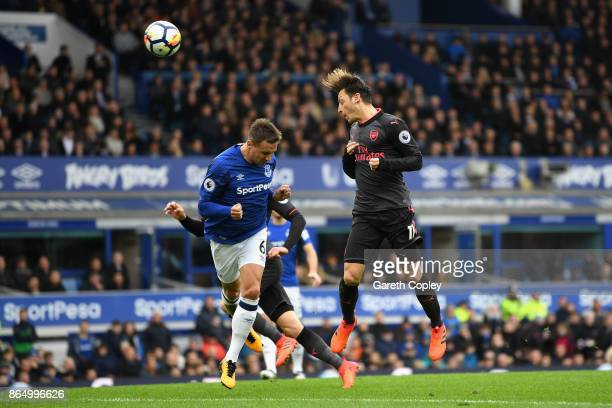 Mesut Ozil of Arsenal scores his sides second goal during the Premier League match between Everton and Arsenal at Goodison Park on October 22 2017 in...