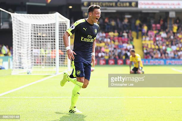 Mesut Ozil of Arsenal scores his sides third goal during the Premier League match between Watford and Arsenal at Vicarage Road on August 27 2016 in...