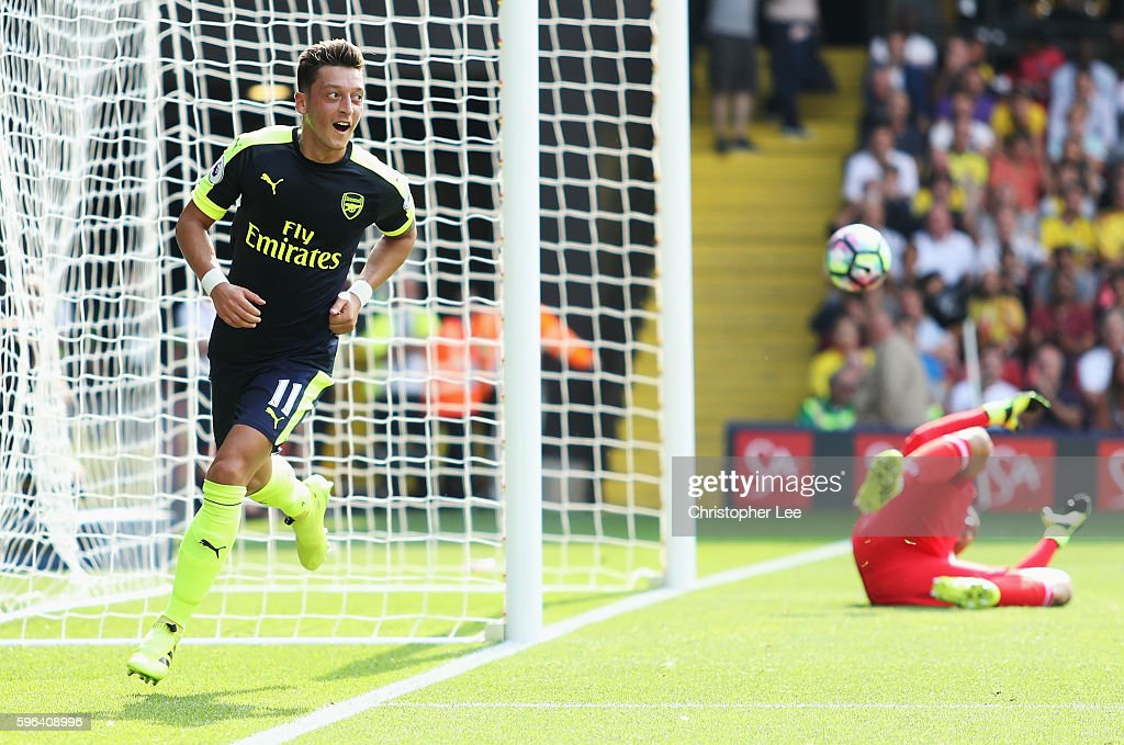 Mesut Ozil of Arsenal scores his sides third goal during the Premier League match between Watford and Arsenal at Vicarage Road on August 27, 2016 in Watford, England.
