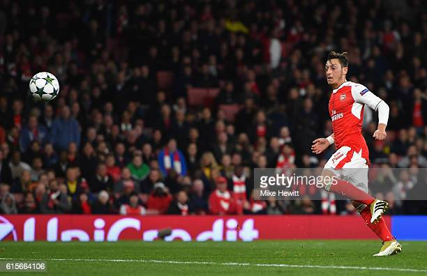 Mesut Ozil of Arsenal scores his team's fifth goal of the game during the UEFA Champions League group A match between Arsenal FC and PFC Ludogorets...