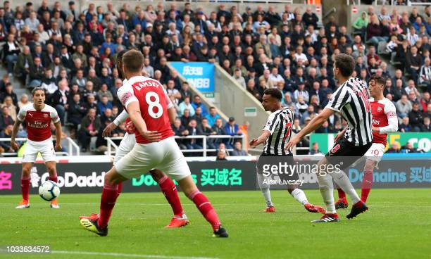 Mesut Ozil of Arsenal scores his team's second goal during the Premier League match between Newcastle United and Arsenal FC at St James Park on...