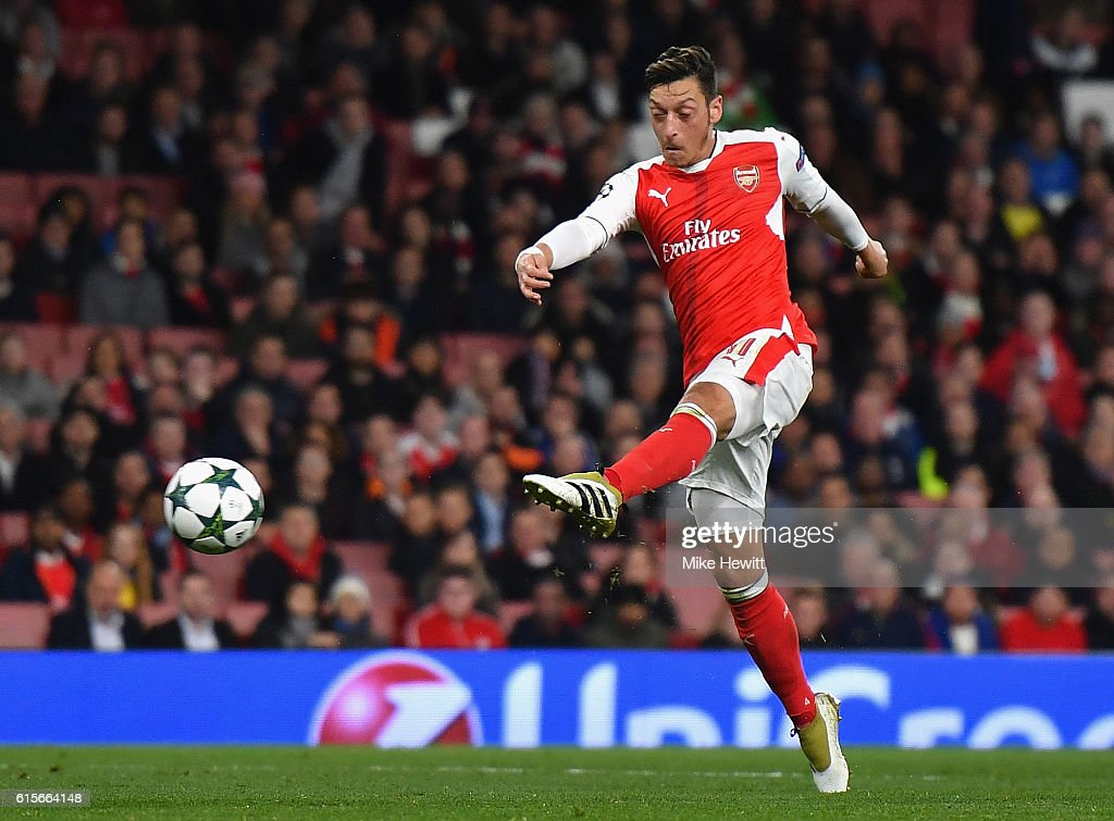 Mesut Ozil of Arsenal scores his team's sixth goal of the game during the UEFA Champions League group A match between Arsenal FC and PFC Ludogorets Razgrad at the Emirates Stadium on October 19, 2016 in London, England.