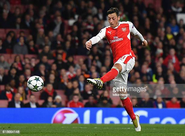 Mesut Ozil of Arsenal scores his team's sixth goal of the game during the UEFA Champions League group A match between Arsenal FC and PFC Ludogorets...