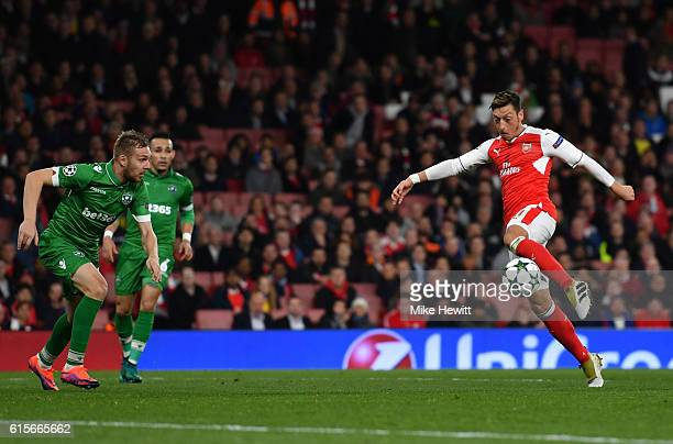 Mesut Ozil of Arsenal scores his third and his team's sixth goal of the game during the UEFA Champions League group A match between Arsenal FC and...