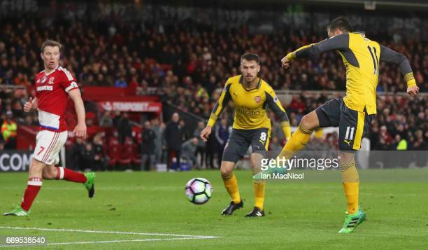 Mesut Ozil of Arsenal scores their second goal during the Premier League match between Middlesbrough and Arsenal at Riverside Stadium on April 17...