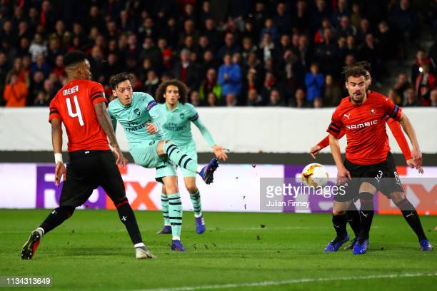 Mesut Ozil of Arsenal shoots at goal during the UEFA Europa League Round of 16 First Leg match between Stade Rennais and Arsenal at Roazhon Park on...