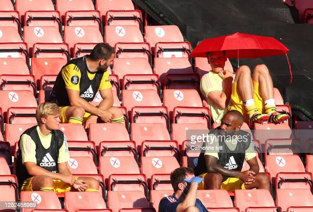 Mesut Ozil of Arsenal sits in the stands under an umbrella during the Premier League match between Southampton FC and Arsenal FC at St Mary's Stadium...