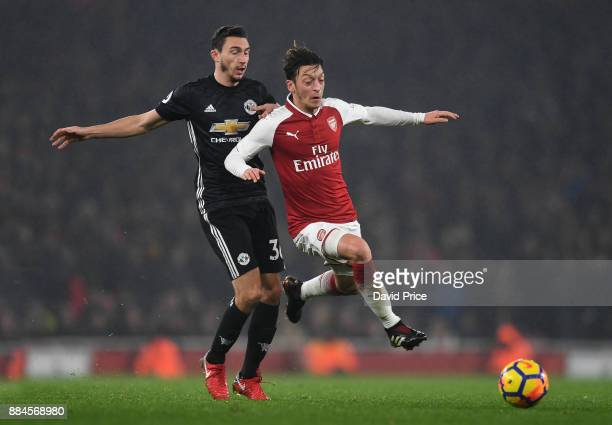 Mesut Ozil of Arsenal skips past Matteo Darmian of Man Utd during the Premier League match between Arsenal and Manchester United at Emirates Stadium...