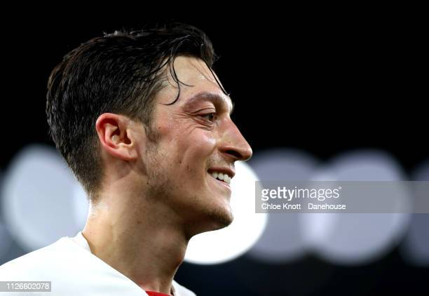 Mesut Ozil of Arsenal smiles during the UEFA Europa League Round of 32 Second Leg match between Arsenal FC and Bate Borisov at Emirates Stadium on...