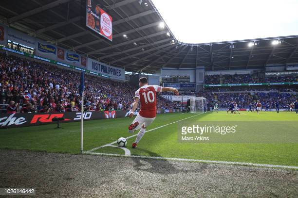 Mesut Ozil of Arsenal takes a corner during the Premier League match between Cardiff City and Arsenal FC at Cardiff City Stadium on September 2 2018...