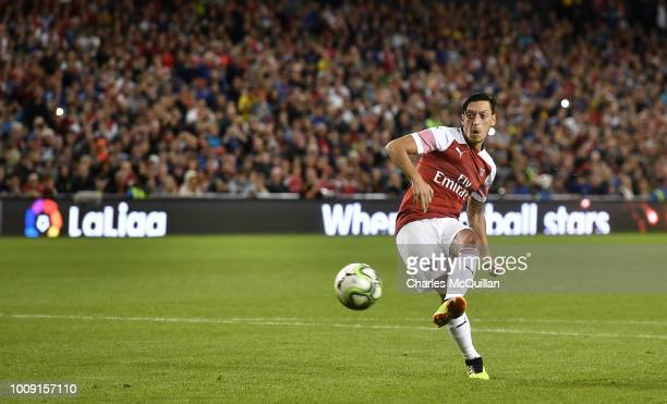 Mesut Ozil of Arsenal takes a penalty during the shoot out following the Preseason friendly International Champions Cup game between Arsenal and...