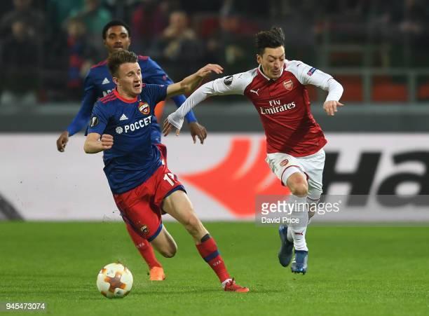 Mesut Ozil of Arsenal takes on Aleksandr Golovin of CSKA during the UEFA Europa League quarter final leg two match between CSKA Moskva and Arsenal FC...
