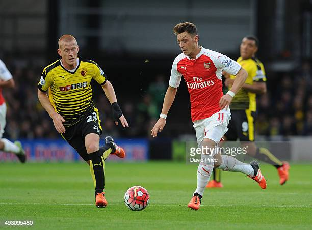 Mesut Ozil of Arsenal takes on Ben Watson of Watford during the Barclays Premier League match between Watford and Arsenal at Vicarage Road on October...