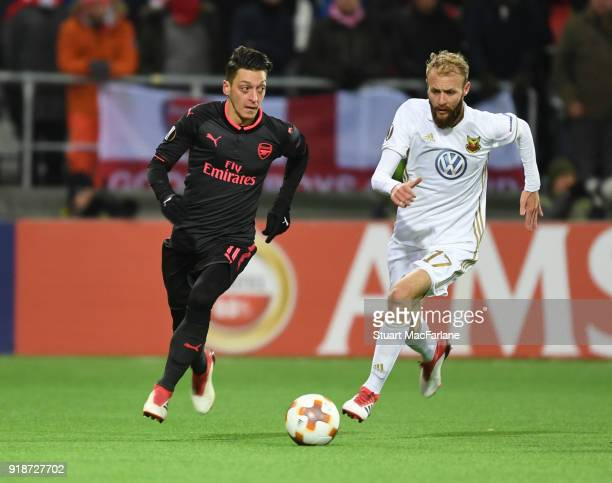 Mesut Ozil of Arsenal takes on Curtis Edwards of Ostersunds during UEFA Europa League Round of 32 match between Ostersunds FK and Arsenal at the...