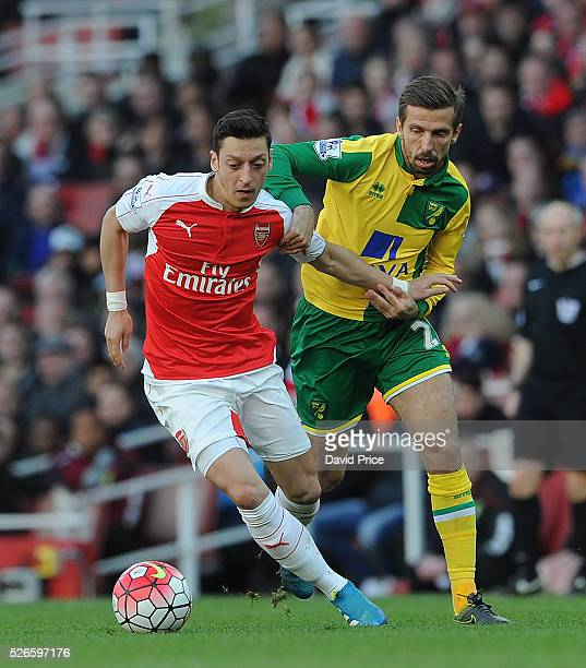 Mesut Ozil of Arsenal takes on Gary O'Neil of Norwich during the Barclays Premier League match between Arsenal and Norwich City at on April 30th 2016...
