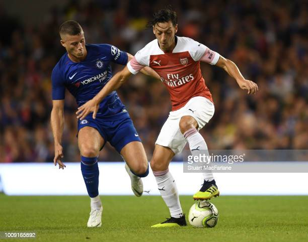 Mesut Ozil of Arsenal takes on Ross Barkley of Chelsea during the Preseason friendly between Arsenal and Chelsea on August 1 2018 in Dublin Ireland