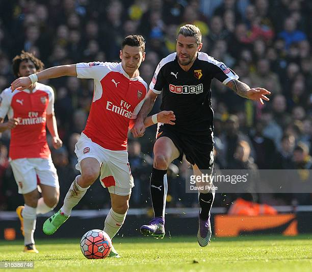 Mesut Ozil of Arsenal takes on Valon Behrami of Watford during the match between Arsenal and Watford in the FA Cup 6th round at Emirates Stadium on...