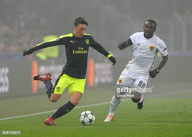 Mesut Ozil of Arsenal under pressure from Seydou Doumbia of Basel during the UEFA Champions League match between FC Basel and Arsenal at St JakobPark...