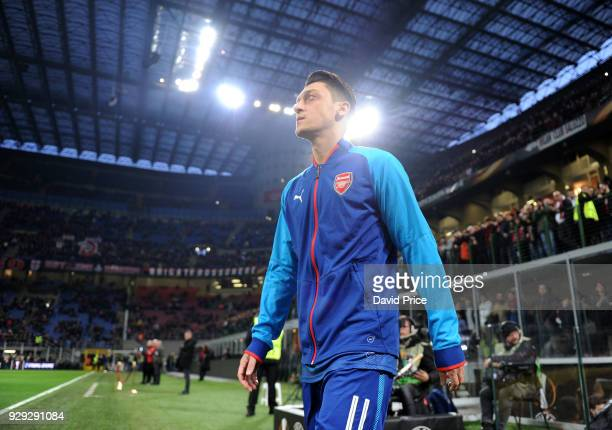 Mesut Ozil of Arsenal walks out onto the pitch for the warm up before UEFA Europa League Round of 16 match between AC Milan and Arsenal at the San...