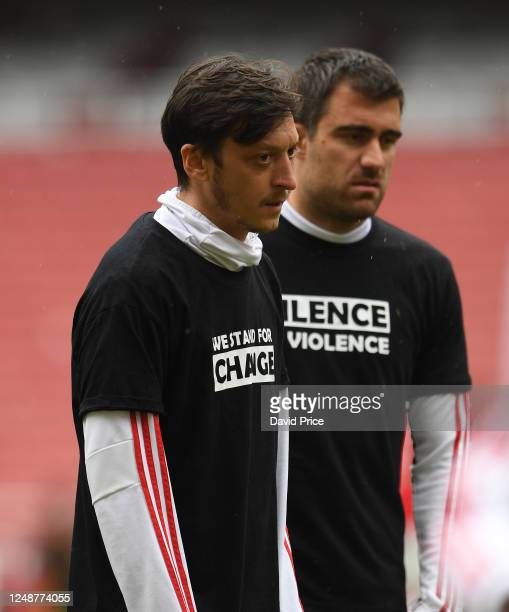Mesut Ozil of Arsenal warms up at half time during the friendly match between Arsenal and Brentford at Emirates Stadium on June 10 2020 in London...