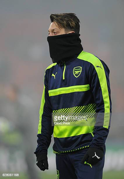 Mesut Ozil of Arsenal warms up before the UEFA Champions League match between FC Basel and Arsenal at St JakobPark on December 6 2016 in Basel...