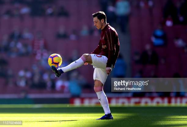 Mesut Ozil of Arsenal warms up prior to the Premier League match between Arsenal FC and Southampton FC at Emirates Stadium on February 23 2019 in...