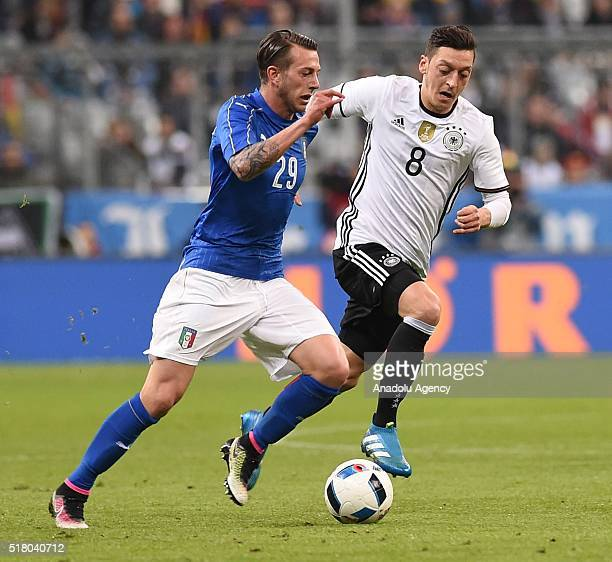 Mesut Ozil of Germany and Federico Bernardeschi of Italy vie for the ball during the friendly football match between Germany and Italy in the Allianz...