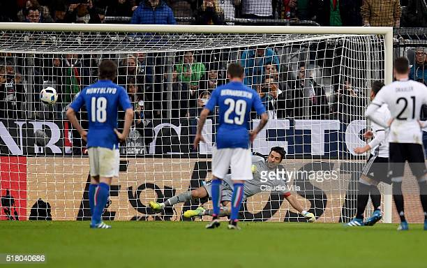 Mesut Ozil of Germany scores the third goal during the international friendly match between Germany and Italy at Allianz Arena on March 29 2016 in...