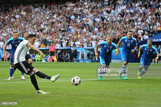 Mesut Ozil of Germany takes and misses a penalty kick during the UEFA Euro 2016 Round of 16 match between Germany and Slovakia at Stade PierreMauroy...