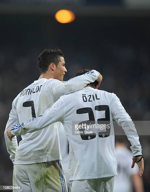 Mesut Ozil of Real Madrid celebrates with Cristiano Ronaldo after scoring Real's third goal during the Copa del Rey quarter final first leg match...
