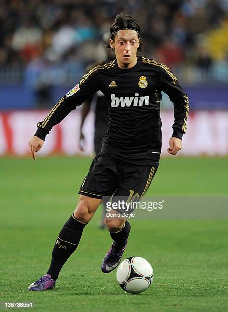Mesut Ozil of Real Madrid controls the ball during the round of 16 Copa del Rey second leg match between Real Madrid and Malaga at La Rosaleda...