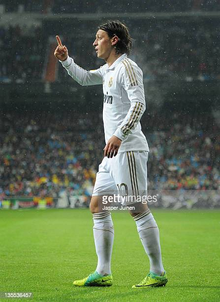 Mesut Ozil of Real Madrid gestures during the la Liga match between Real Madrid and Barcelona at Estadio Santiago Bernabeu on December 10, 2011 in...