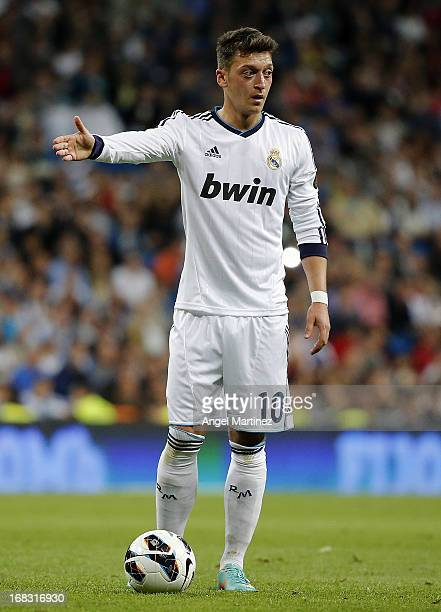 Mesut Ozil of Real Madrid gestures during the La Liga match between Real Madrid and Malaga at Estadio Santiago Bernabeu on May 8 2013 in Madrid Spain