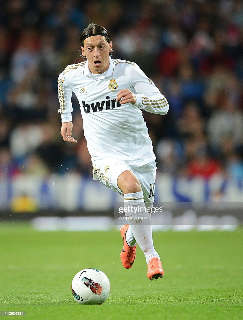 Mesut Ozil of Real Madrid runs with the ball during the La Liga match between Real Madrid CF and Real Sporting de Gijon at the Estadio Santiago Bernabeu on April 14, 2012 in Madrid, Spain.