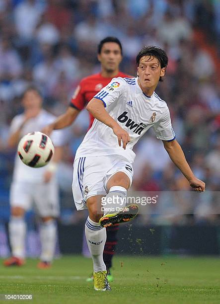 Mesut Ozil of Real Madrid tries to surprise the Osasuna goalkeeper with a long shot during the La Liga match between Real Madrid and Osasuna at...