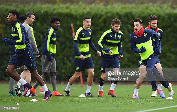 Mesut Ozil performs drills with team mates during an Arsenal training session on the eve of their UEFA Champions League match against Paris...