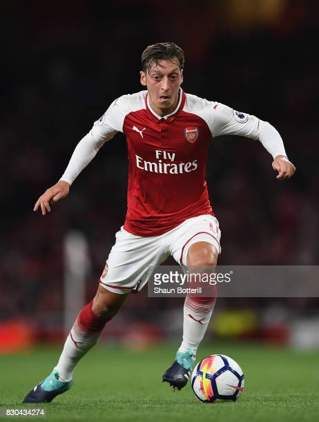 Mesut Ozil running with the ball during the Premier League match between Arsenal and Leicester City at Emirates Stadium on August 11 2017 in London...