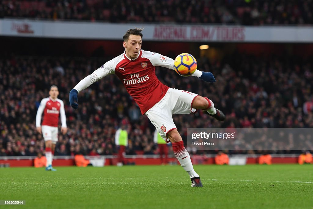 Mesut Ozil scores a goal for Arsenal during the Premier League match between Arsenal and Newcastle United at Emirates Stadium on December 16, 2017 in London, England.