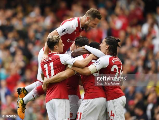 Mesut Ozil Shkodran Mustafi Sead Kolasinac and Hector Bellerin celebrate the 1st Arsenal goal scored by Alex Lacazette during the Premier League...